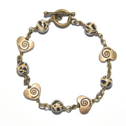 Animal skin polymer clay bracelet with antique brass hearts