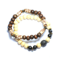 Two bracelets - wood, lava stone and antique brass