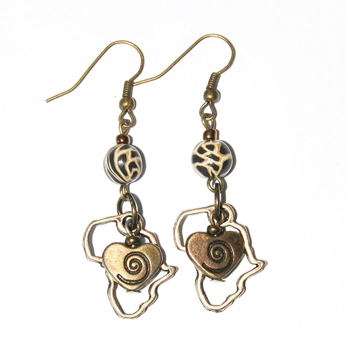 Animal skin polymer clay earrings with antique brass hearts in Africa