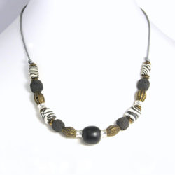 Zebraskin polymer clay, wood, lava and antique brass on metallic leather necklace