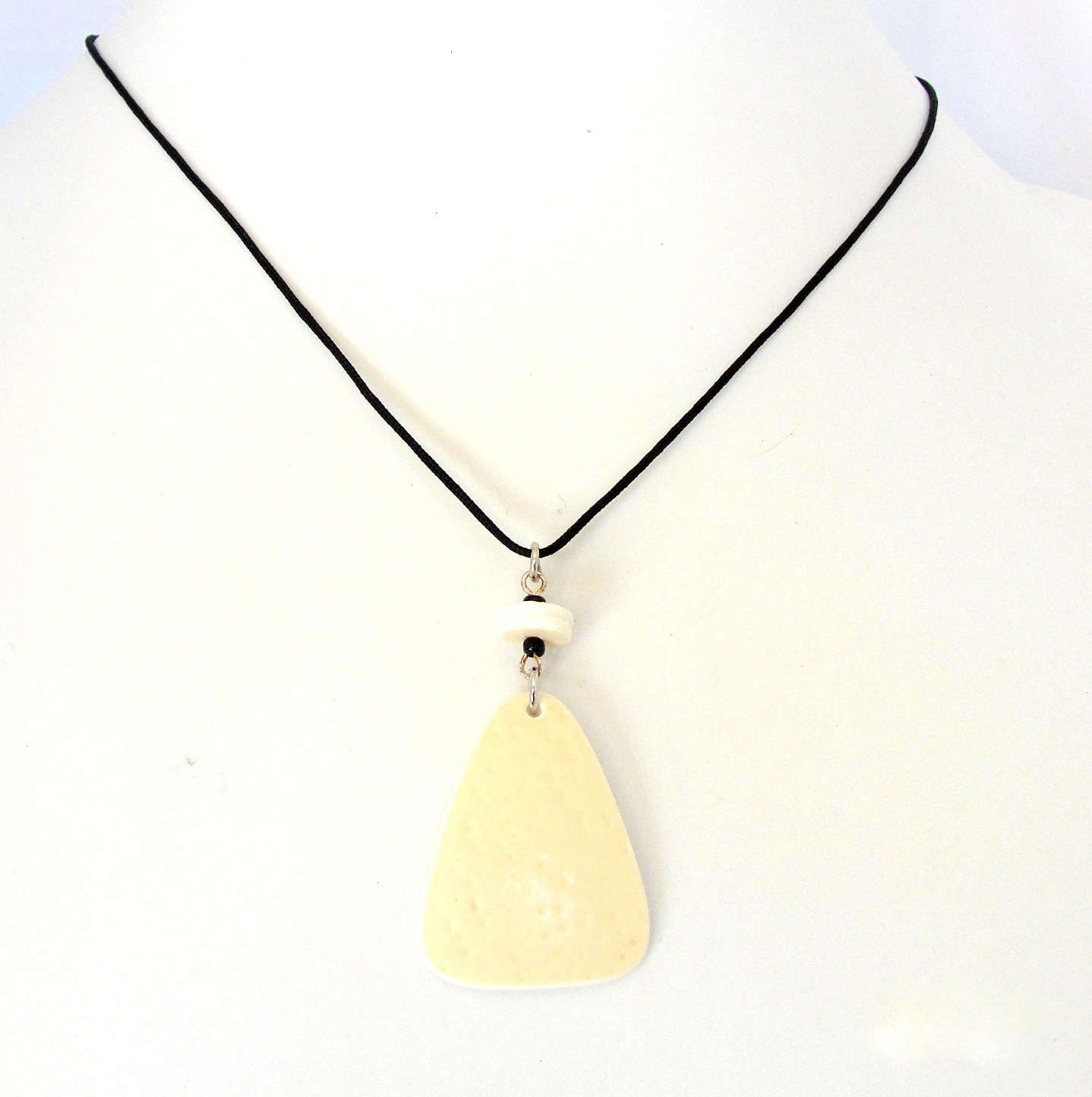 Oval ostrich shell pendant on cord necklace