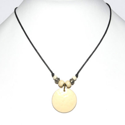 Small round ostrich shell pendant on cord necklace