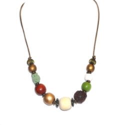Assorted beads on metallic bronze leather