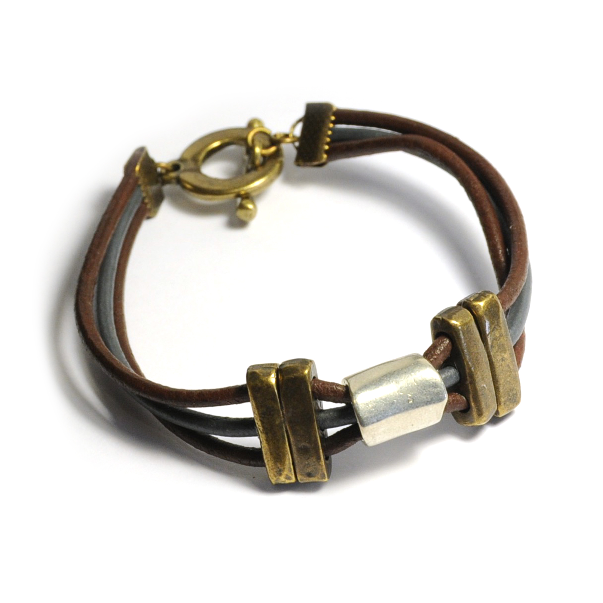 Leather bracelet threaded through antique brass metal and elegant silver feature