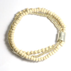 Off-white wood with silver coloured glass 3 strand bracelet with elegant metal feature