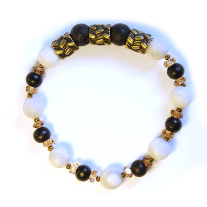 White agate and lava stone compliment this antique brass feature bracelet