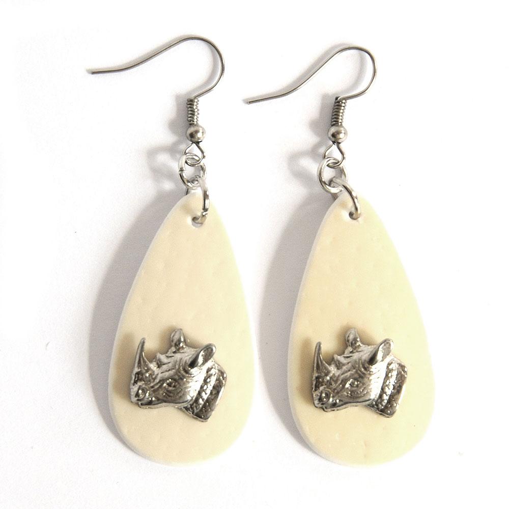 Ostrich eggshell earrings with rhino heads
