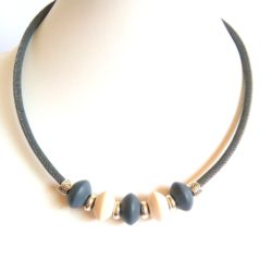 Grey cork necklace, with wooden discs and silver colour spacers.