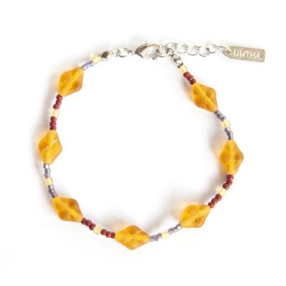 Golden diagonal Czech glass bracelet with feature colour small glass beads.